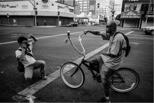 Shooting street photography in Downtown LA with the Leica M9, 35mm lens, and off-camera flash. Photo by Rinzi Ruiz