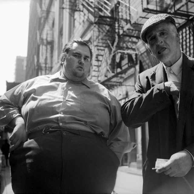 April 19, 1971. Chicago, IL / Photograph by Vivian Maier. Note the 'juxtaposition' between the fat man on the left, and the skinny man on the right.