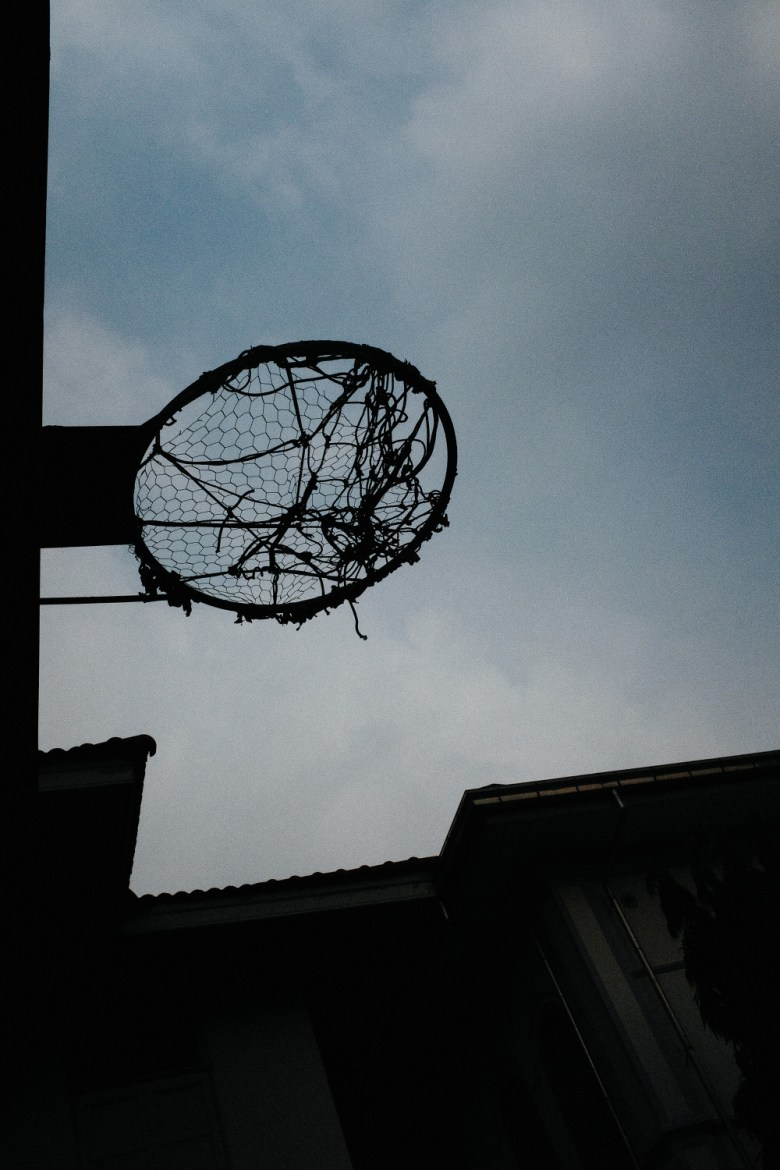 Silhouette of basketball hoop. Shot looking up, -1 exposure compensation. Bangkok, 2017