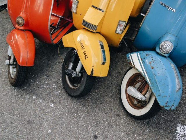 Red, yellow, and blue vespas.