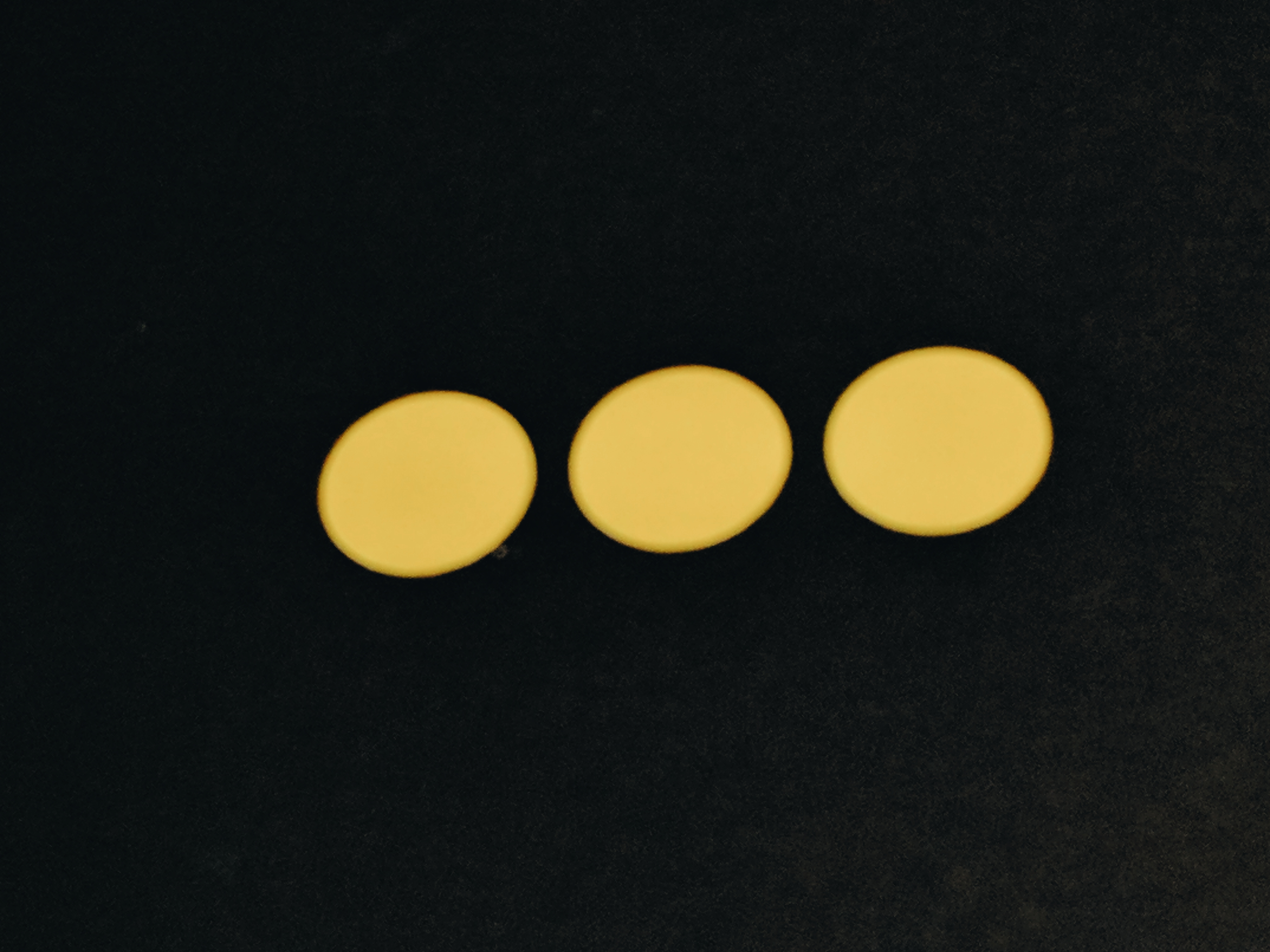 Three yellow Dots on black background