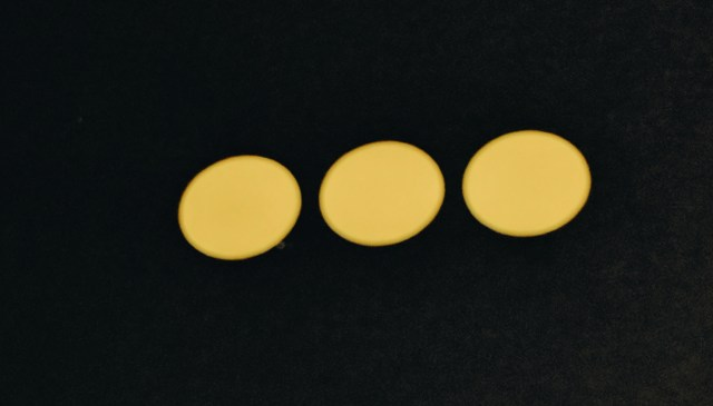 Three yellow Dots on black background