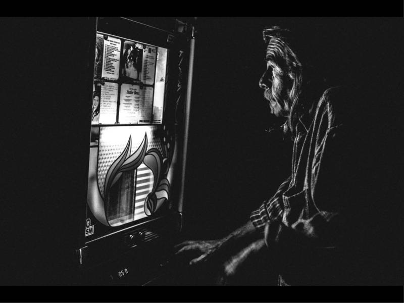 Man at jukebox. The old colony, Provincetown 2016