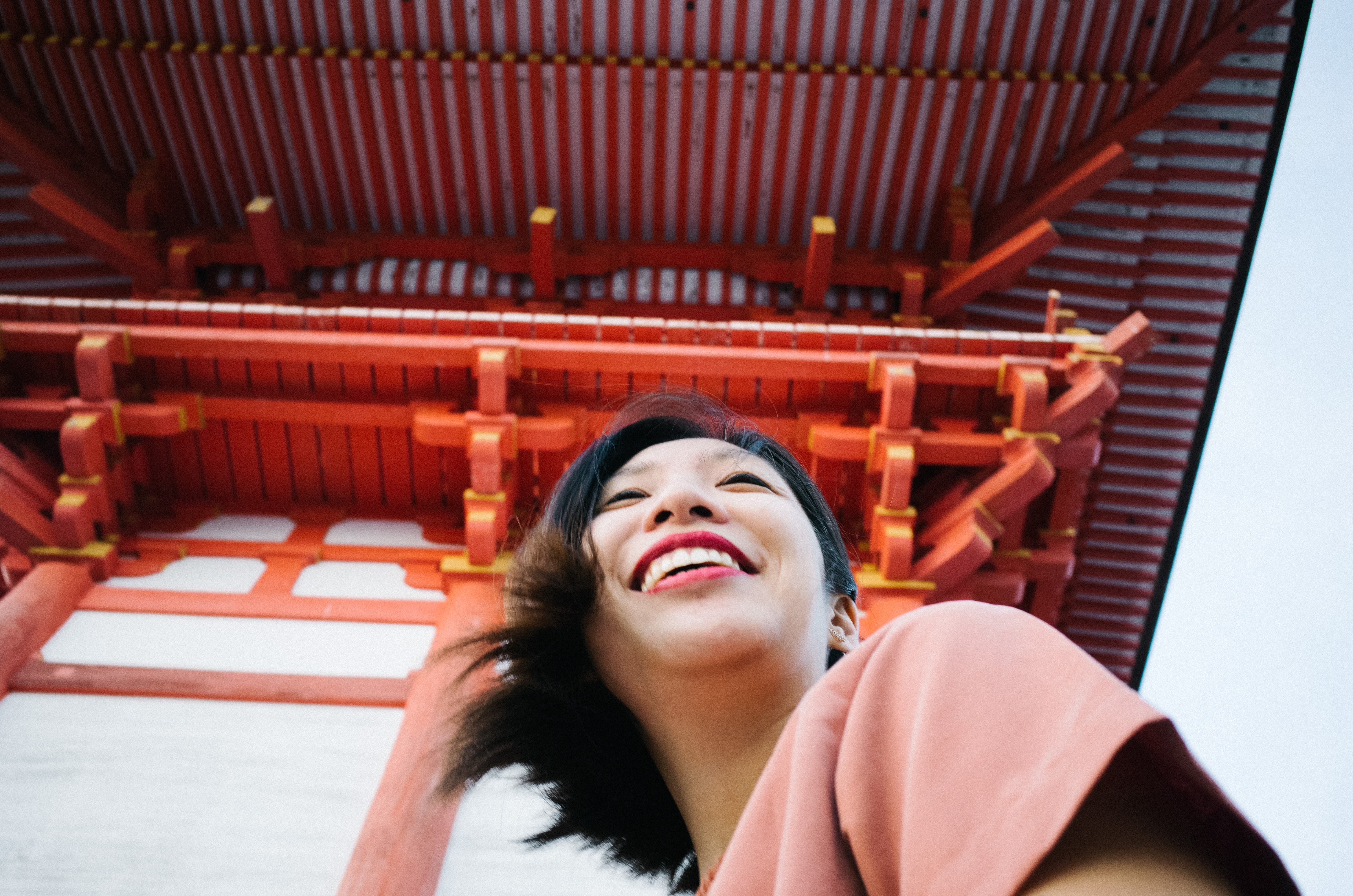 Cindy laughing at red shrine. Kyoto, 2017.