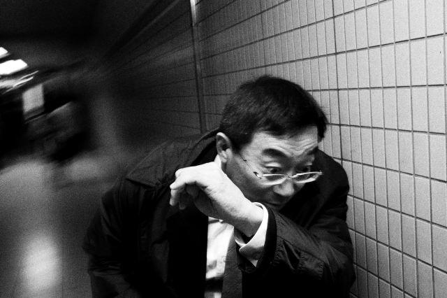 Man dodging. Tokyo, 2011.