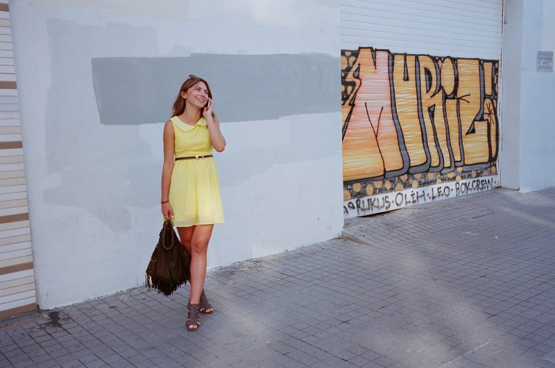 Girl in yellow dress on her phone. Istanbul, 2014