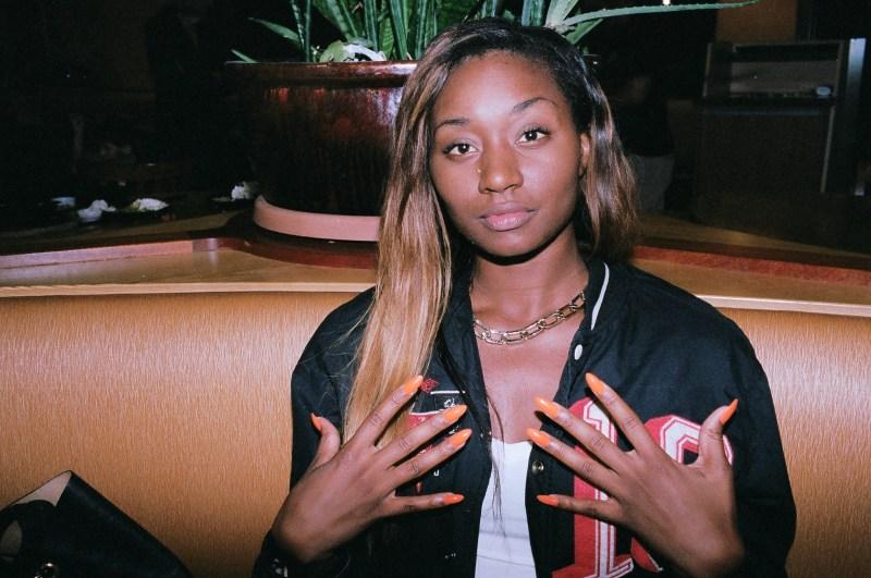 Houston, Texas. Girl with orange nails.