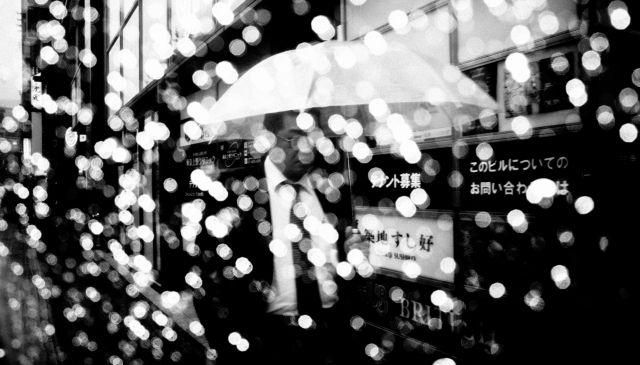 DARK SKIES OVER TOKYO / Man with umbrella.