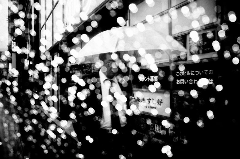 DARK SKIES OVER TOKYO / Man with umbrella.