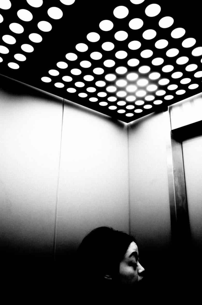 Woman in elevator. Tokyo, 2016.