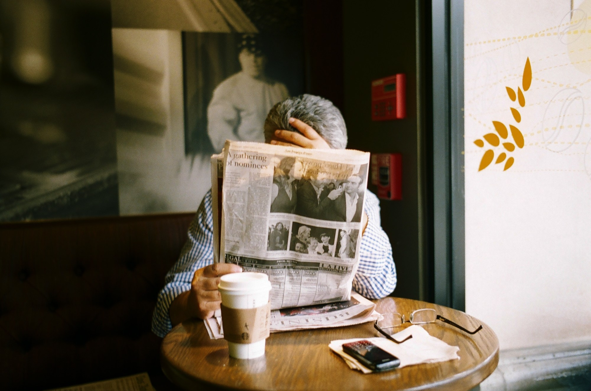 Natural light, listening to the light meter. Leica M6 + Leica Summicron 35mm f2 ASPH + Kodak Portra 400. Man with newspaper. Beverly Hills, 2012. Leica M6, 35mm lens, Kodak Portra 400. Shot around 1.5 meters.