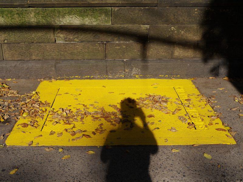 Yellow manhole cover.