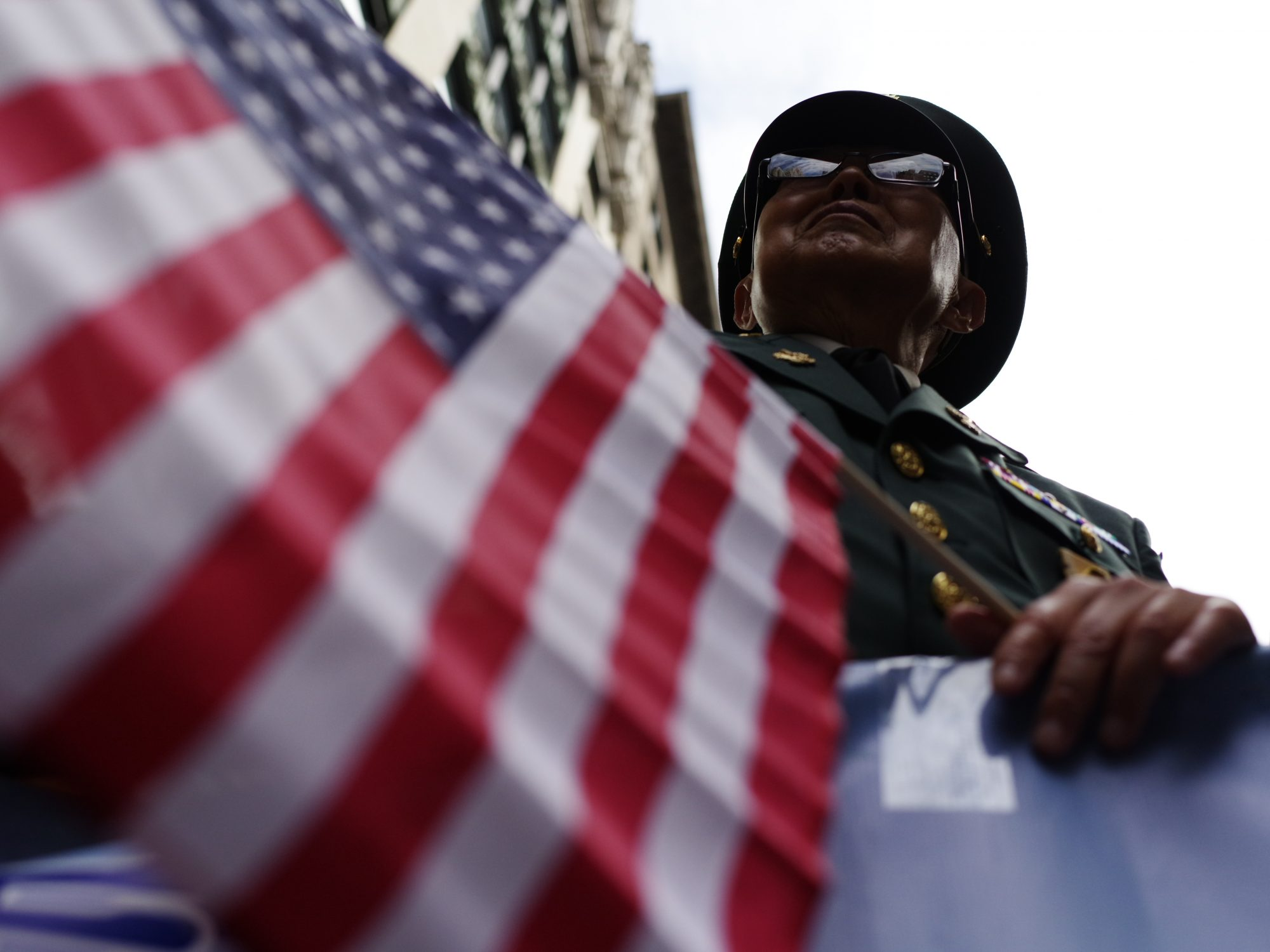 Korean veteran. American flag. NYC.