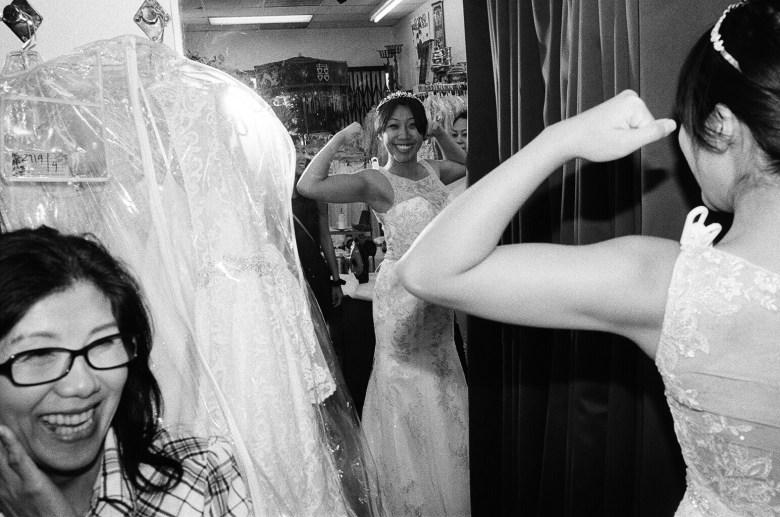 Cindy flexing in mirror.