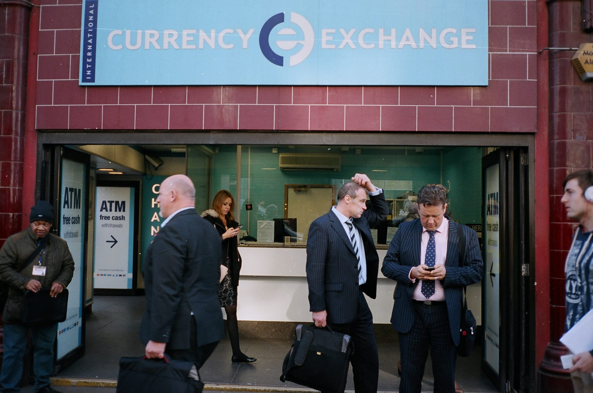 Currency exchange, suits, 2014. London.
