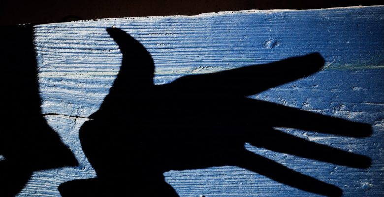 Hand abstract and blue background. Marseille, 2017
