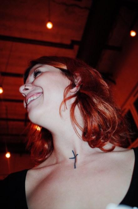 Woman with cross neck tattoo. Berlin, 2017