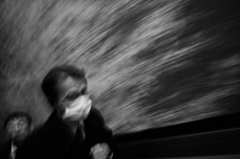 Blurry man in Tokyo, in subway.