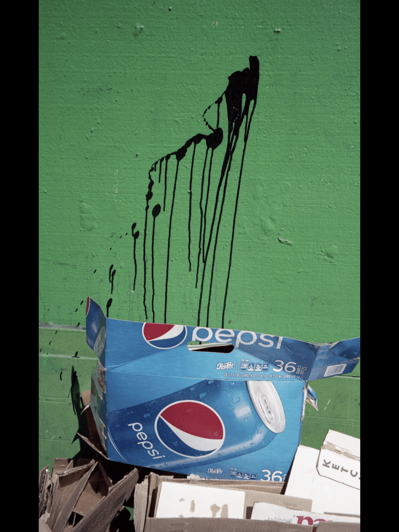 Pepsi with green wall.