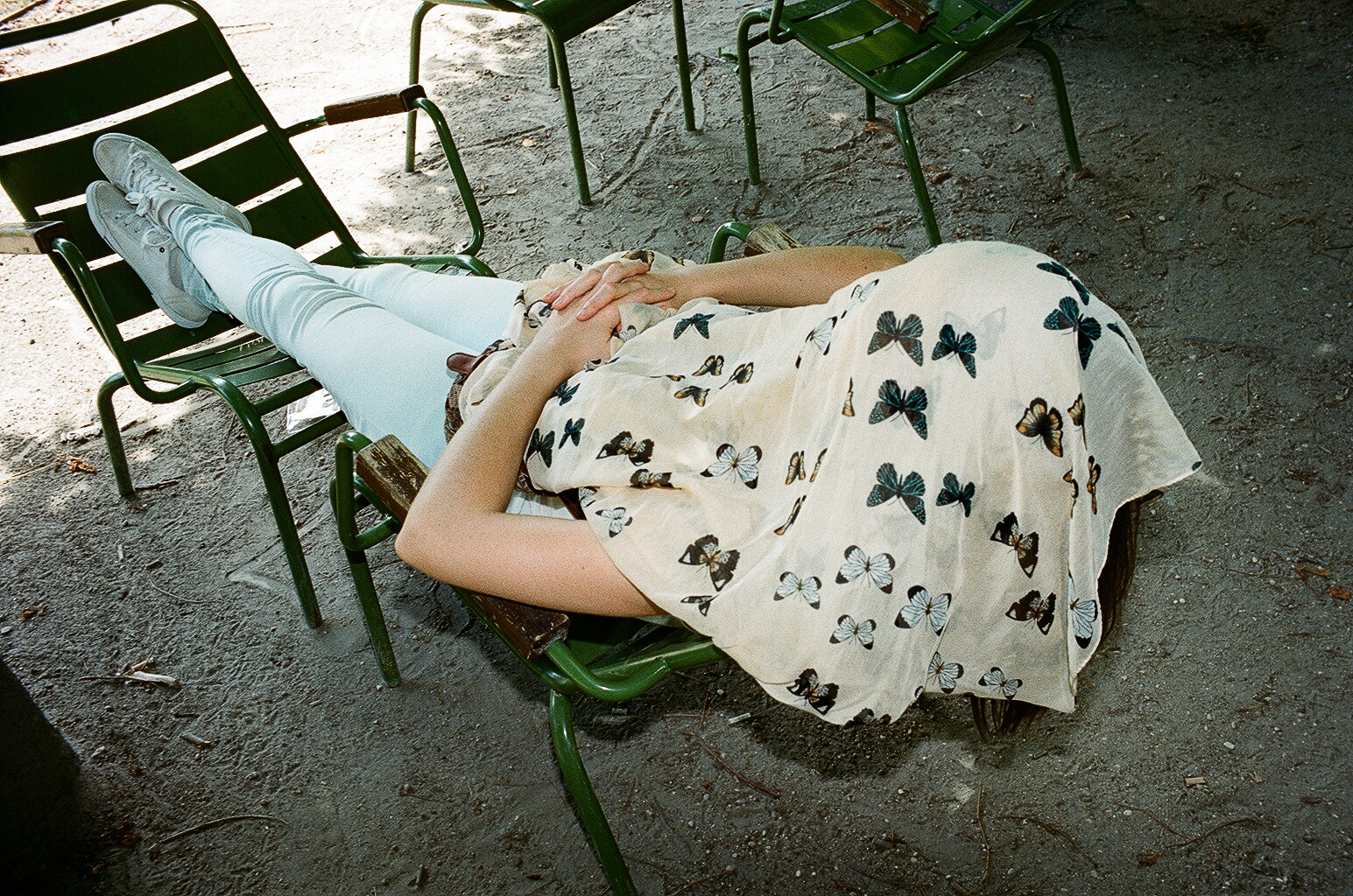 Woman sleeping in Paris, with butterfly cloth.