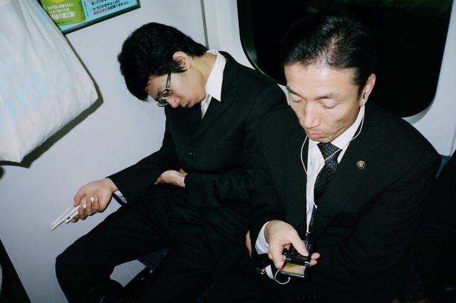 Suits in Tokyo metro.