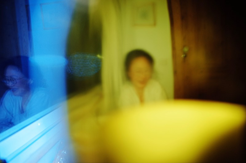Blue and yellow blurry photo of my mom. Lisbon, 2018