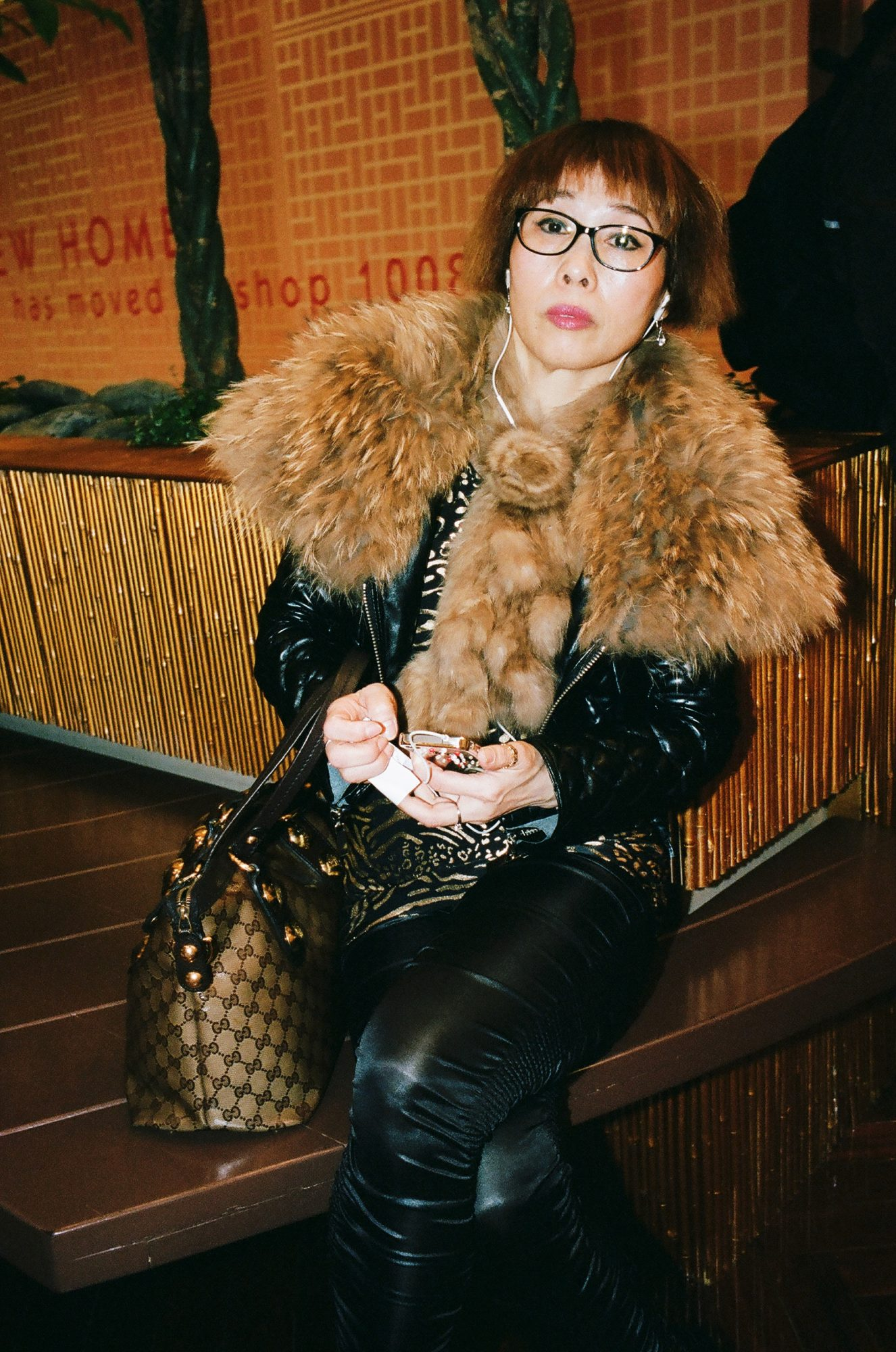 Photograph of a woman in fur I shot inside a Hong Kong Mall, 2013.