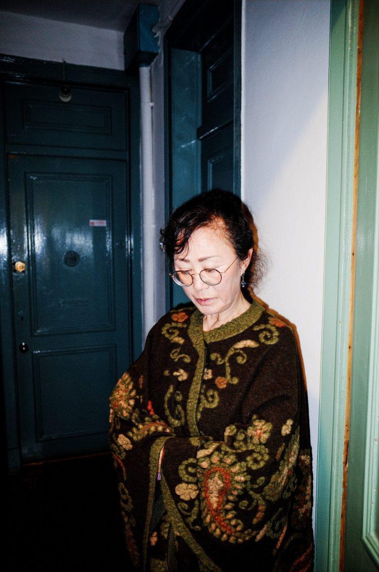 My mom against green door. Lisbon, 2018