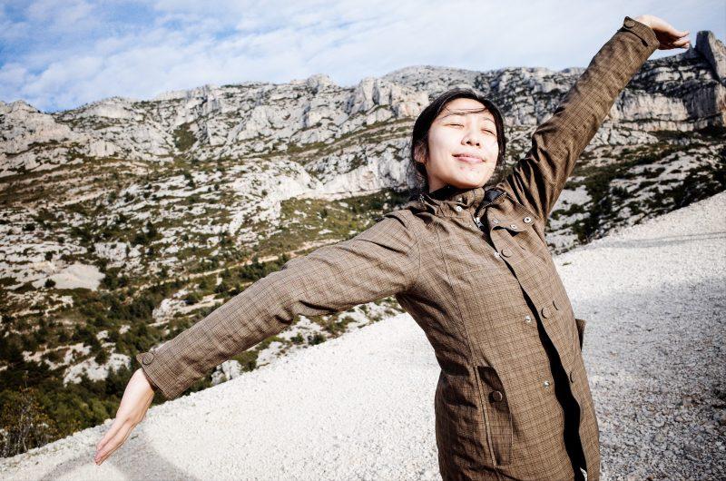 Cindy happy, arms spread. Marseille, 2018