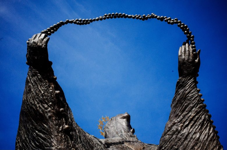 Trust statue Lisbon beads