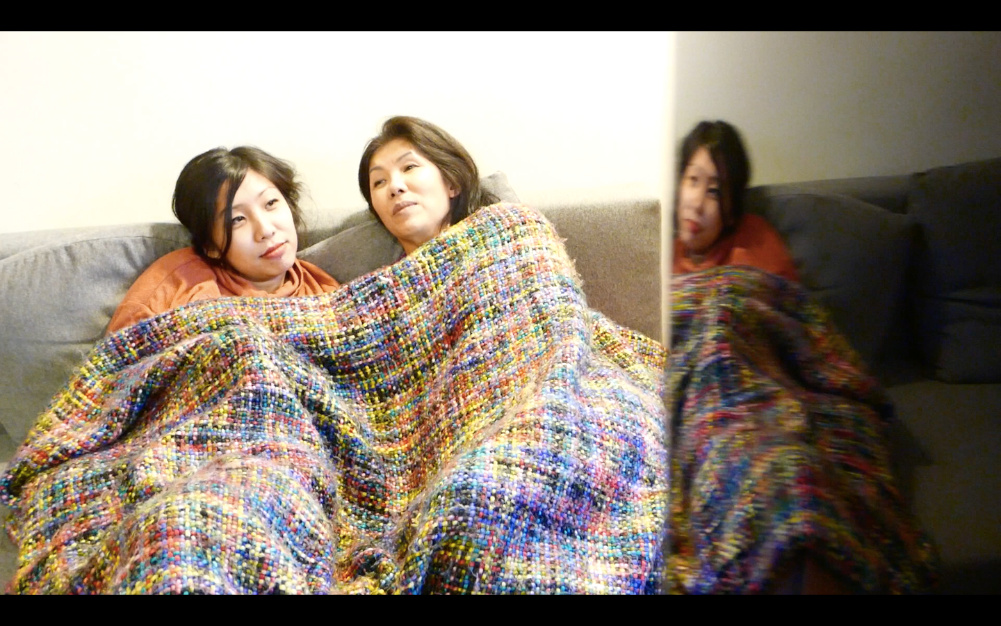 "A composition I shot with the camera right next to the reflective black refrigerator, to get the reflection of Cindy on the far-right. Shot of Cindy and her mother, intentionally blurred (in manual focusing mode), to add more drama and mystery to the shot. ""The Undeniable Force of Khó Khăn"" Film"