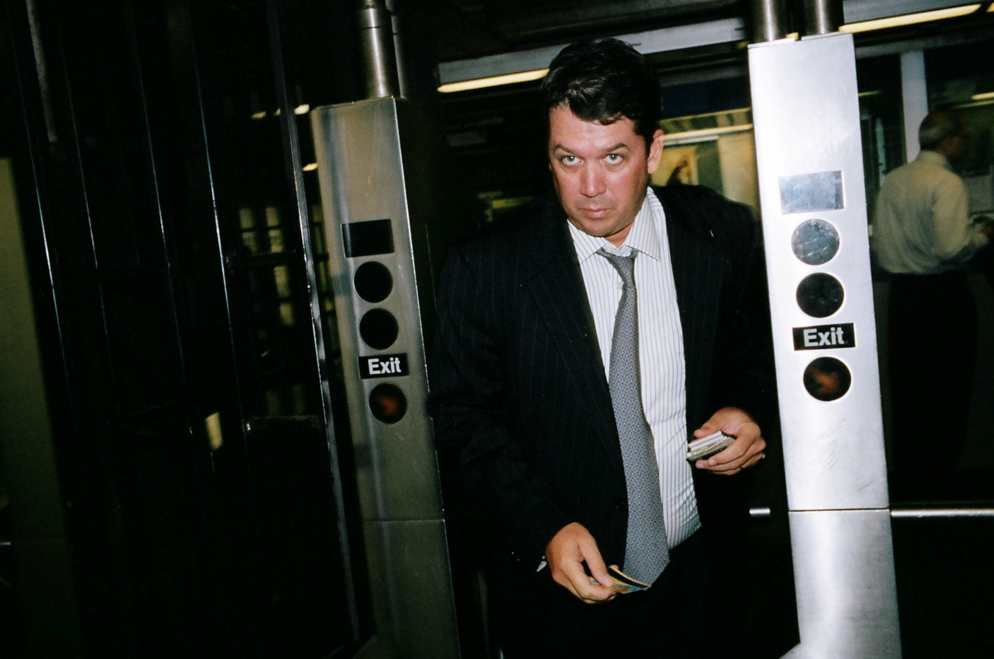 man subway suit turnstile