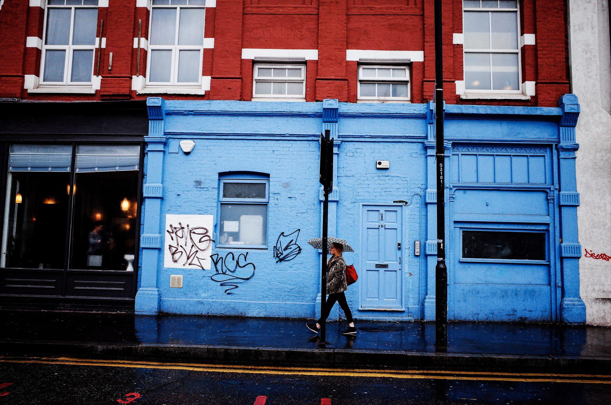 Red, blue, woman walking. London, 2018