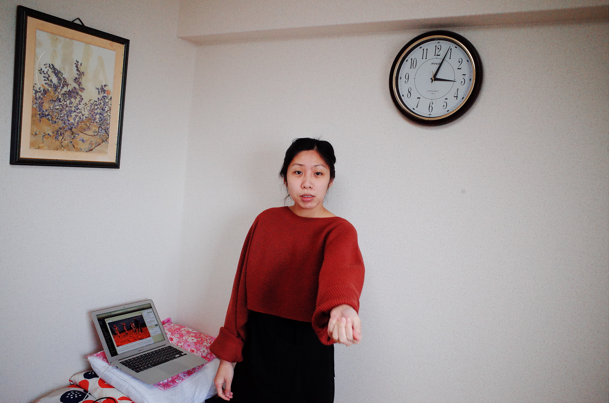 Cindy in living room, with clock in background. Osaka, 2018