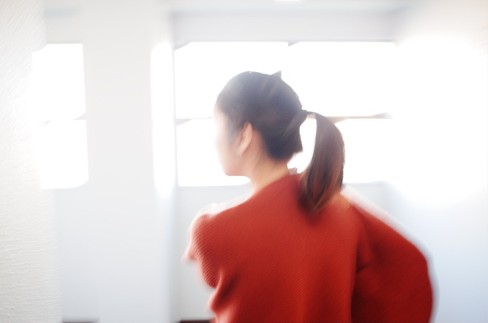 Cindy walking, leaving our Airbnb. Osaka, 2018