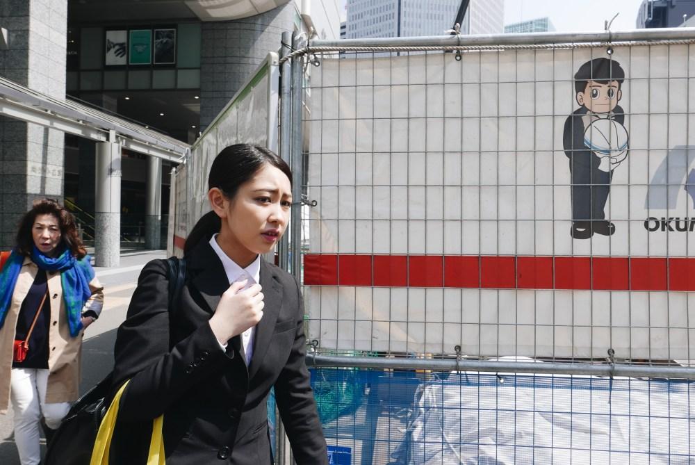 layered movement woman suit osaka station