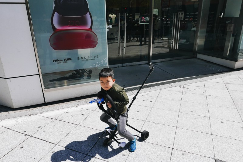 Kid in front of Nike store. Osaka, 2018