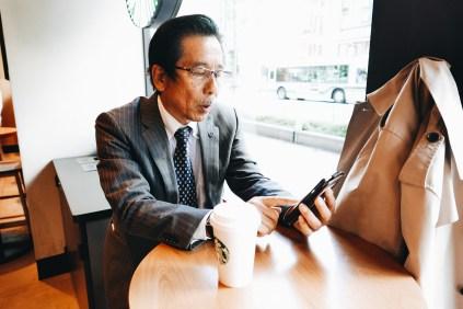 Suit kyoto Starbucks newspaper