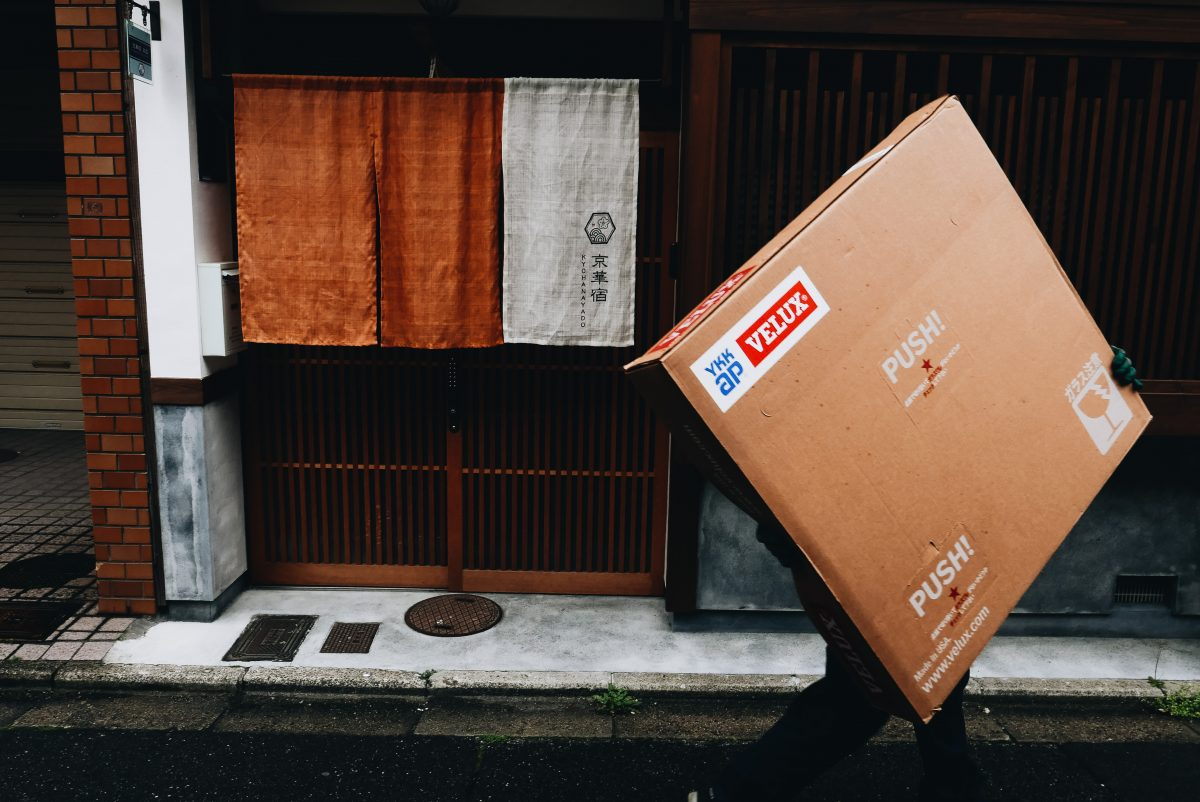 Kyoto man with square box, walking. 2018