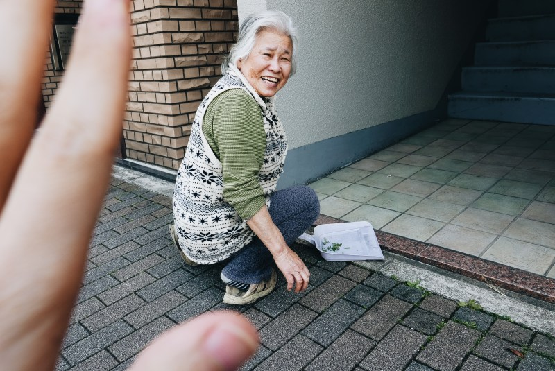 Hand framing hello woman Kyoto old woman