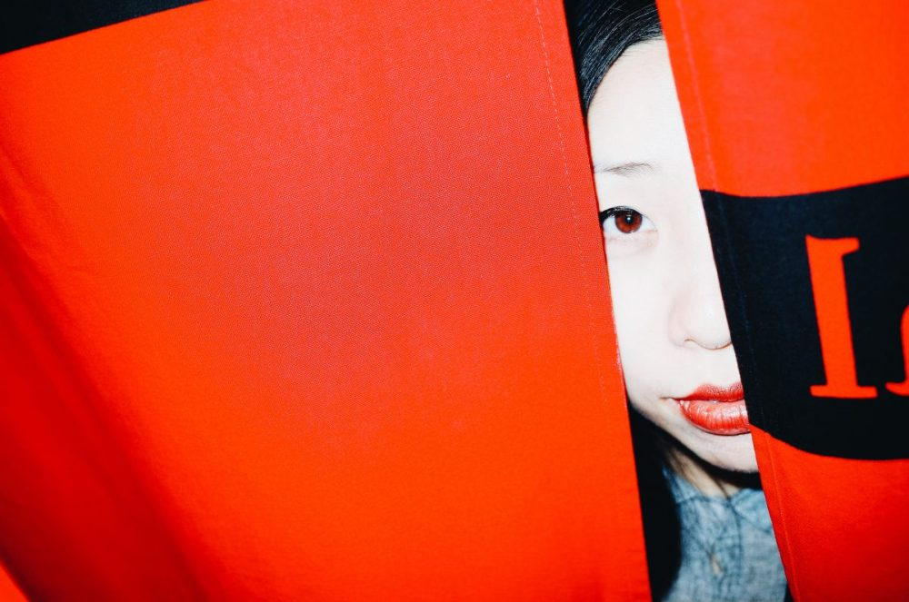Cindy eye and red curtain, flash. Kyoto, 2018