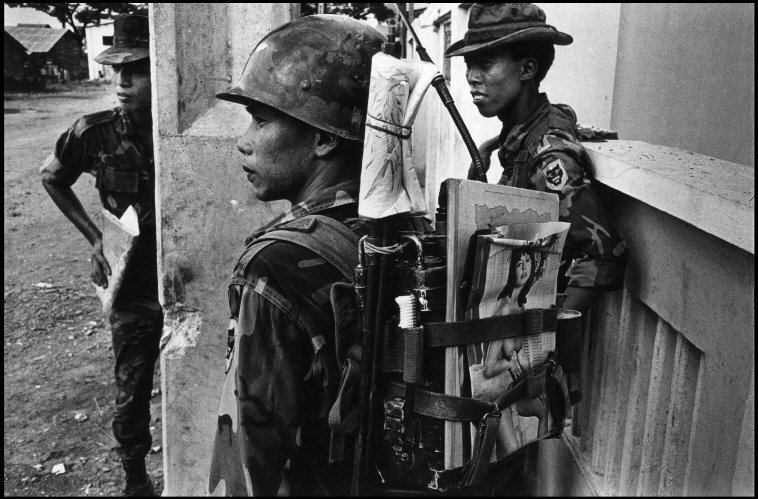 VIETNAM. 1968. ARVN soldier enters battle armed with toothbrush and playmate.
