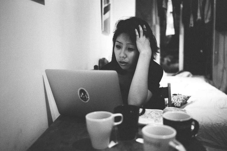 eric-kim-photography-Cindy-Project-black-and-white-4-paris-coffee-hand-stress-laptop.jpg