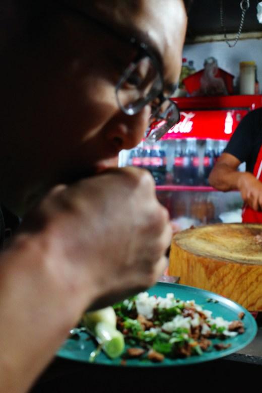Eric eating tacos