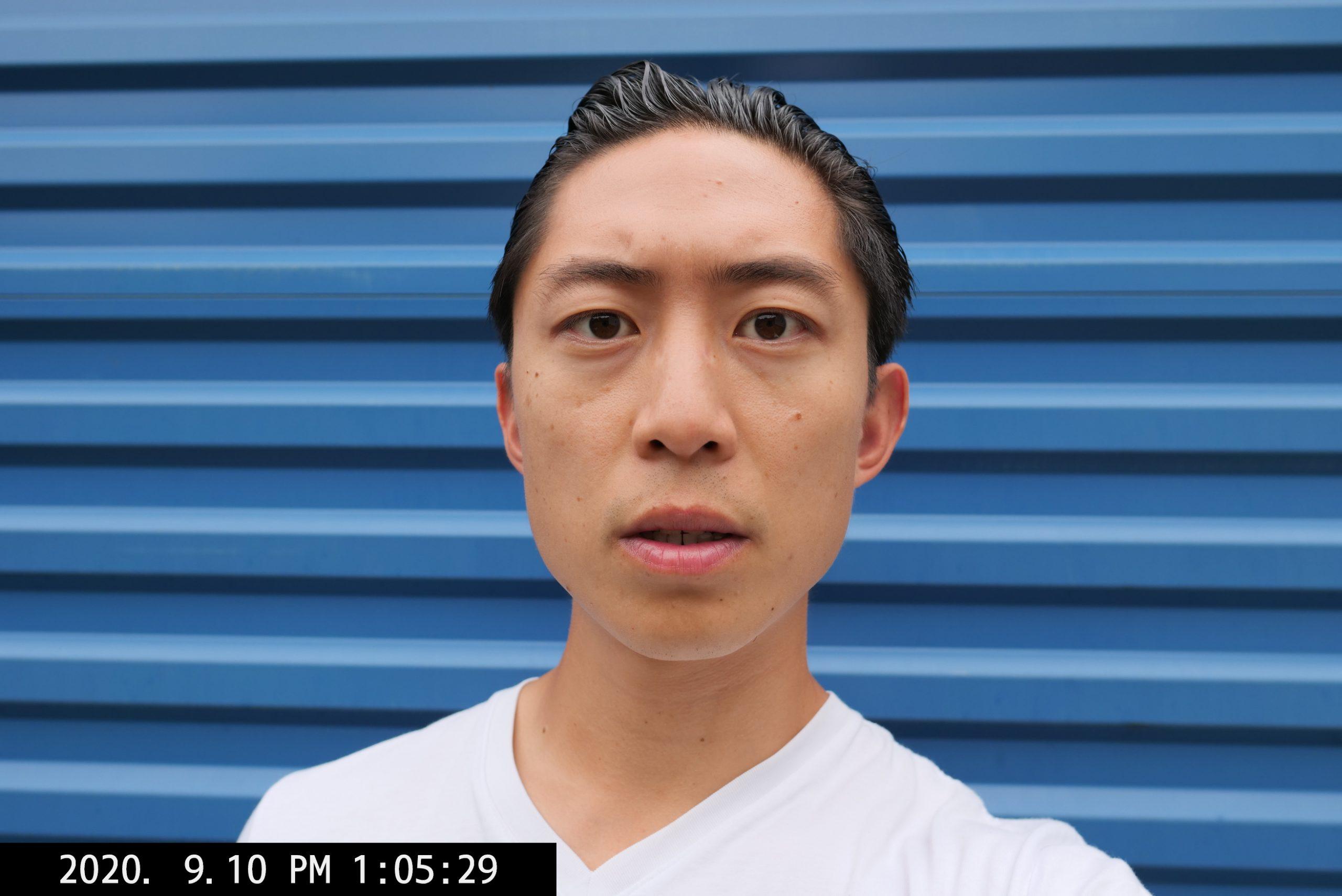 selfie ERIC KIM orange blue