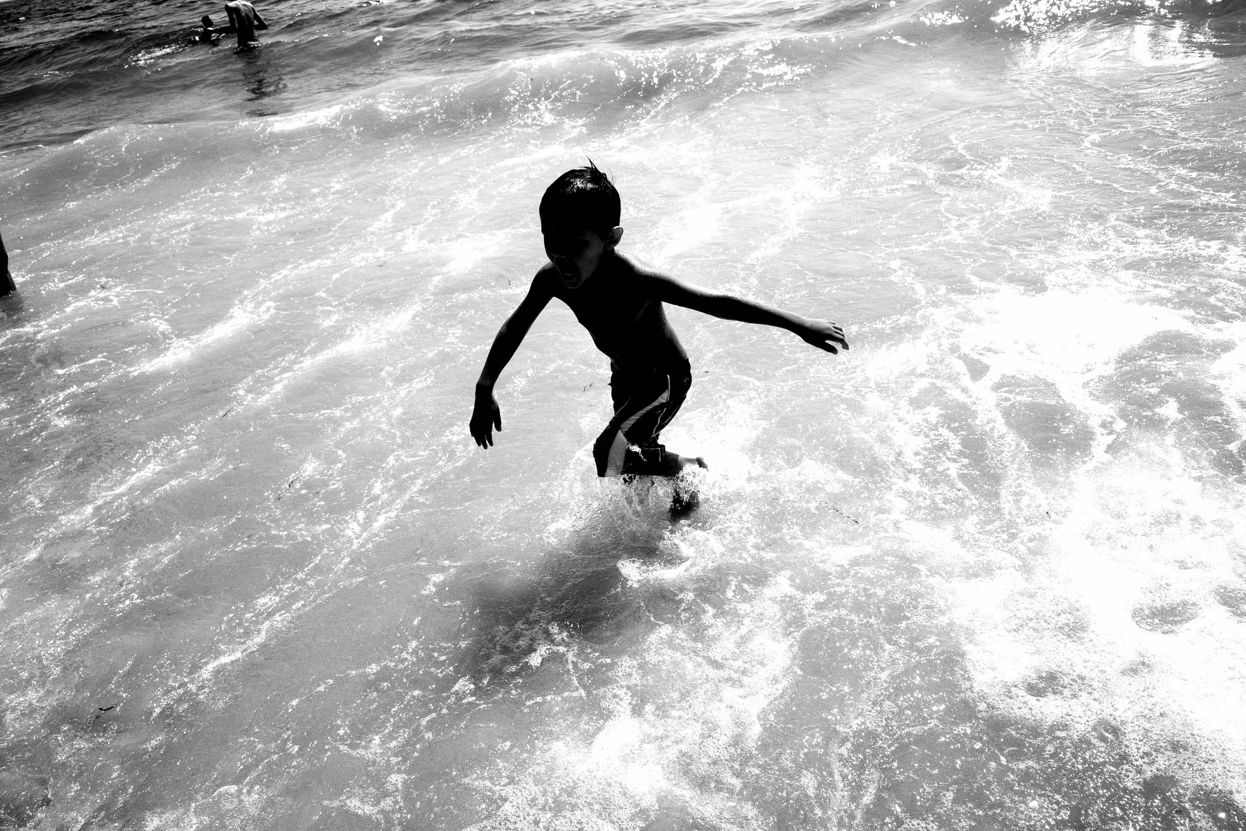 kid in the water playing