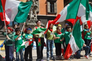 Welcome to Reggio Emilia, Italy, May 2014: Children perform in the Piazza Prampolini near the Duomo.
