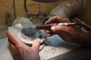 """My dad uses a """"paleo"""" tool to reveal and detail a crab that is millions of years old."""