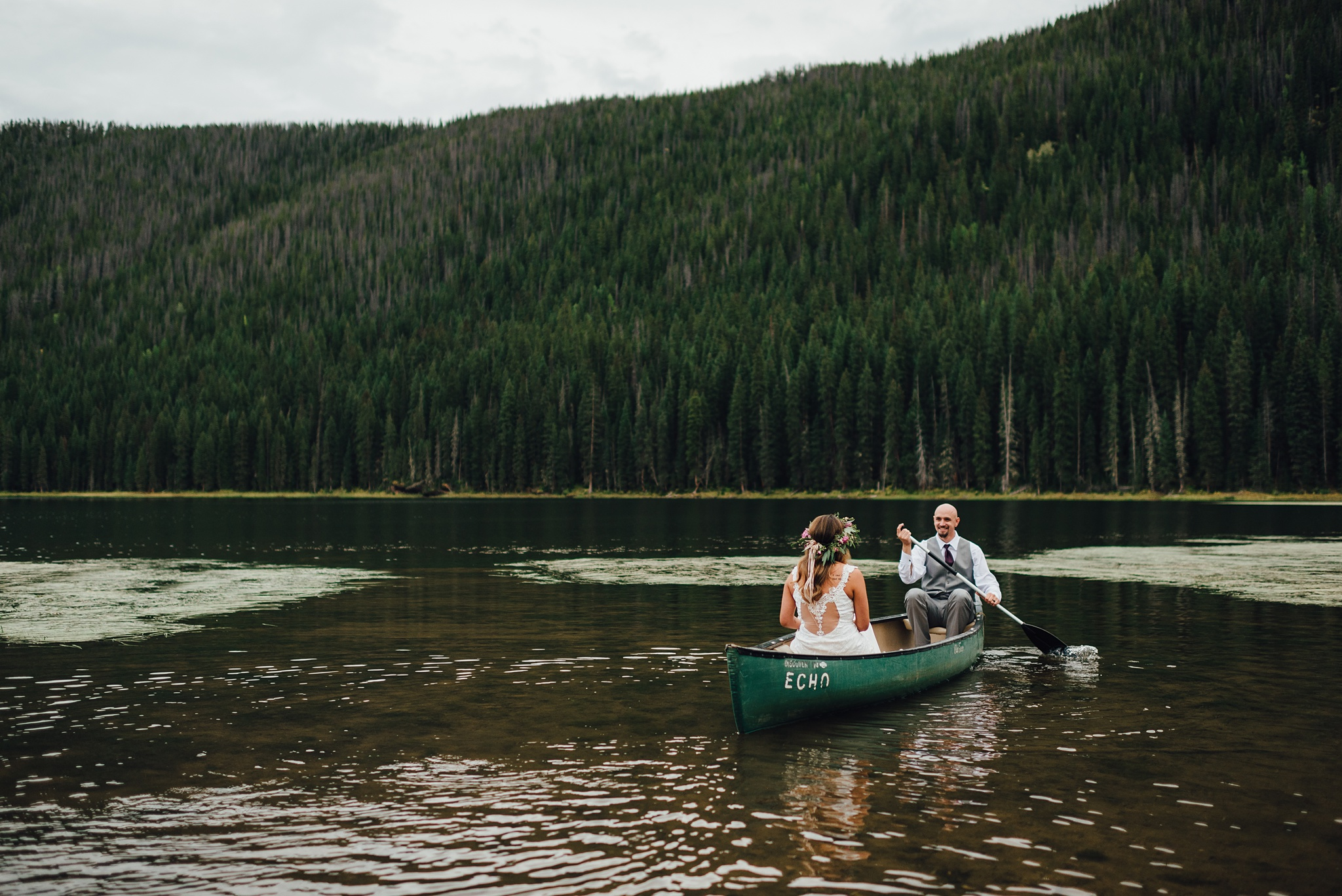 couple canoeing in piney lake, piney river ranch wedding