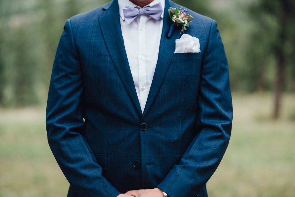groom in blue suit, Calvin Klein